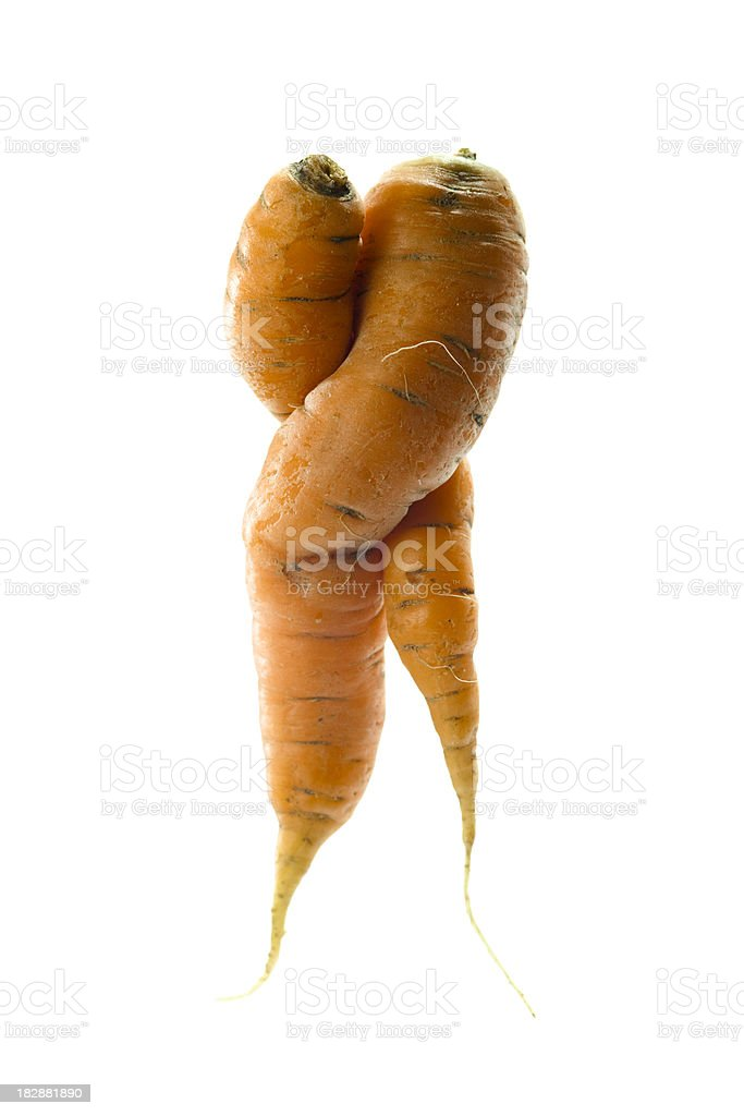 Misshapen Carrots in love. stock photo