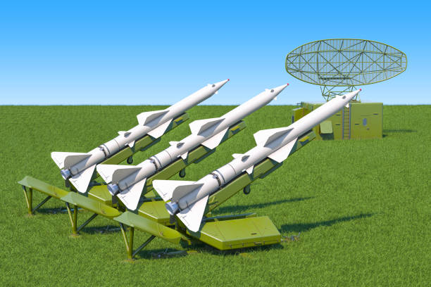 Missile defence system with radar on the green grass against blue sky, 3d rendering Missile defence system with radar on the green grass against blue sky, 3d rendering antiaircraft stock pictures, royalty-free photos & images