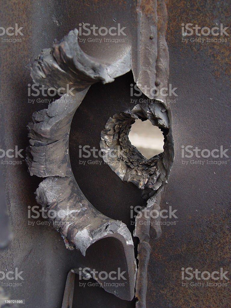 Missile through Steel stock photo