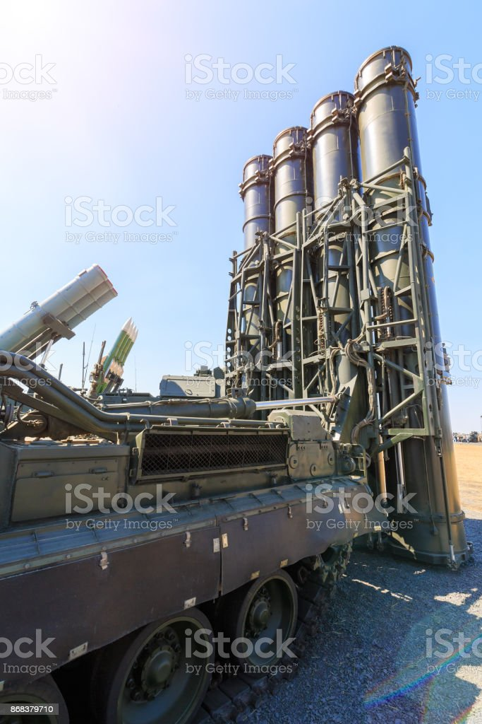Missiles and rockets of various types are directed to the blue sky as illustration of 100% defense stock photo