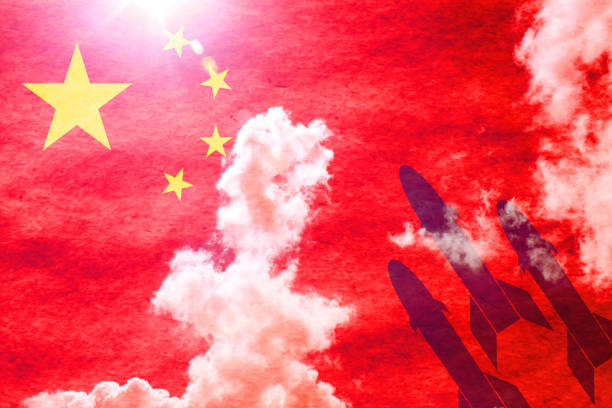 Missiles in front of sunny chinese flag stock photo