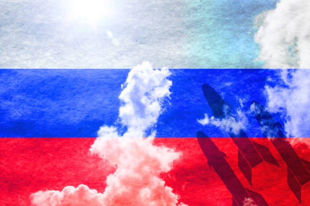 missiles in front of sunny russian flag - nuclear weapon stock photos and pictures