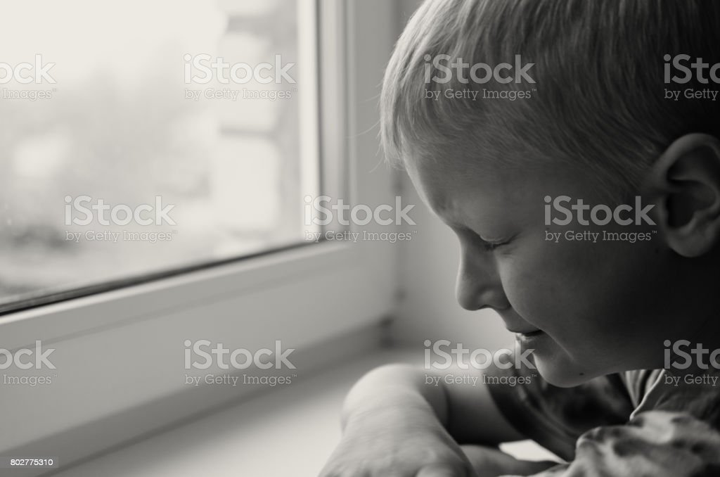 Missing child. Abandoned toy. Loneliness. Black and white image. stock photo