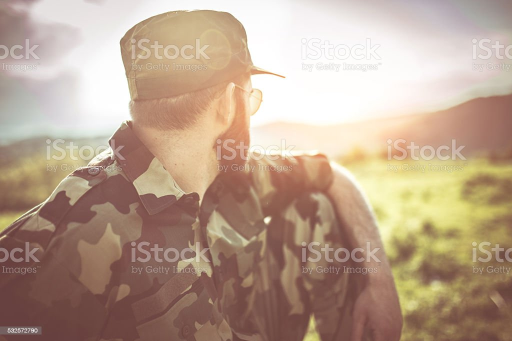 War, army and people concept - young soldier or ranger wearing...