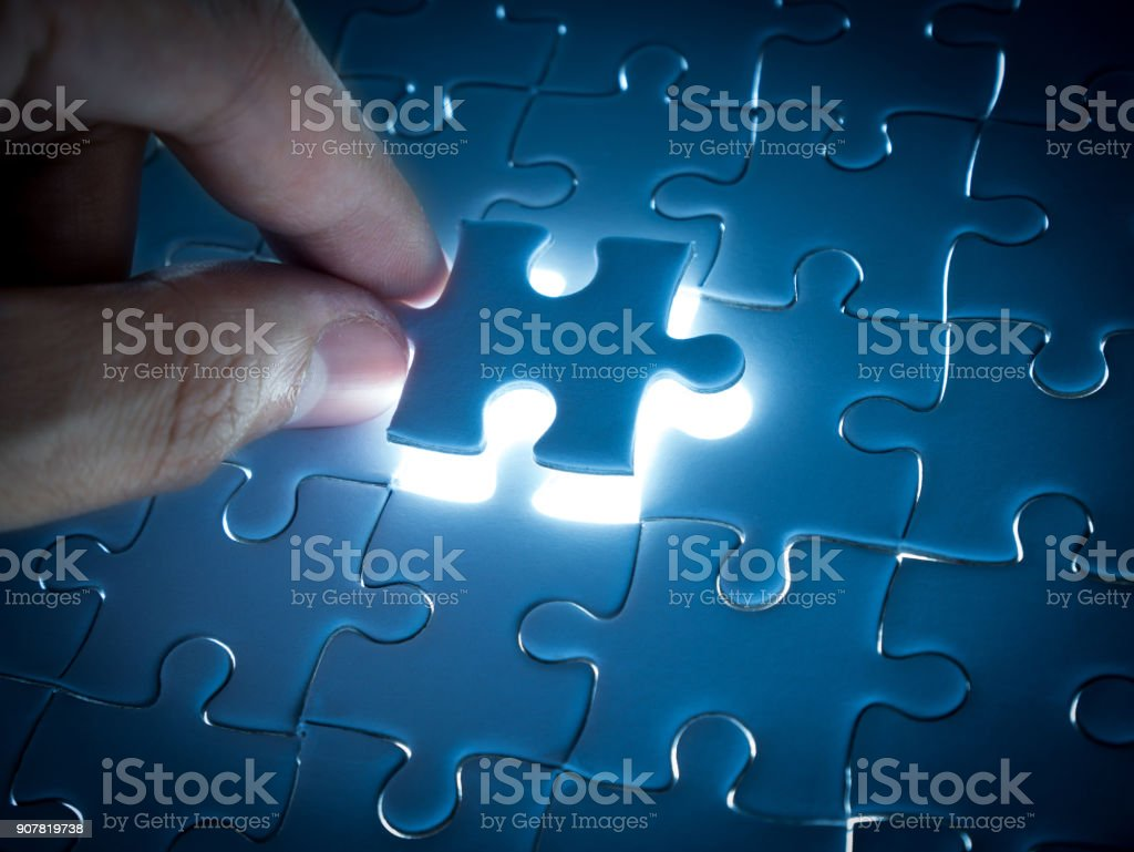 Missing Jigsaw puzzle piece with lighting, business concept for...