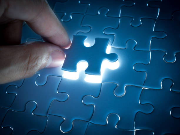 Missing Jigsaw puzzle piece with lighting, business concept for completing the finishing puzzle piece stock photo