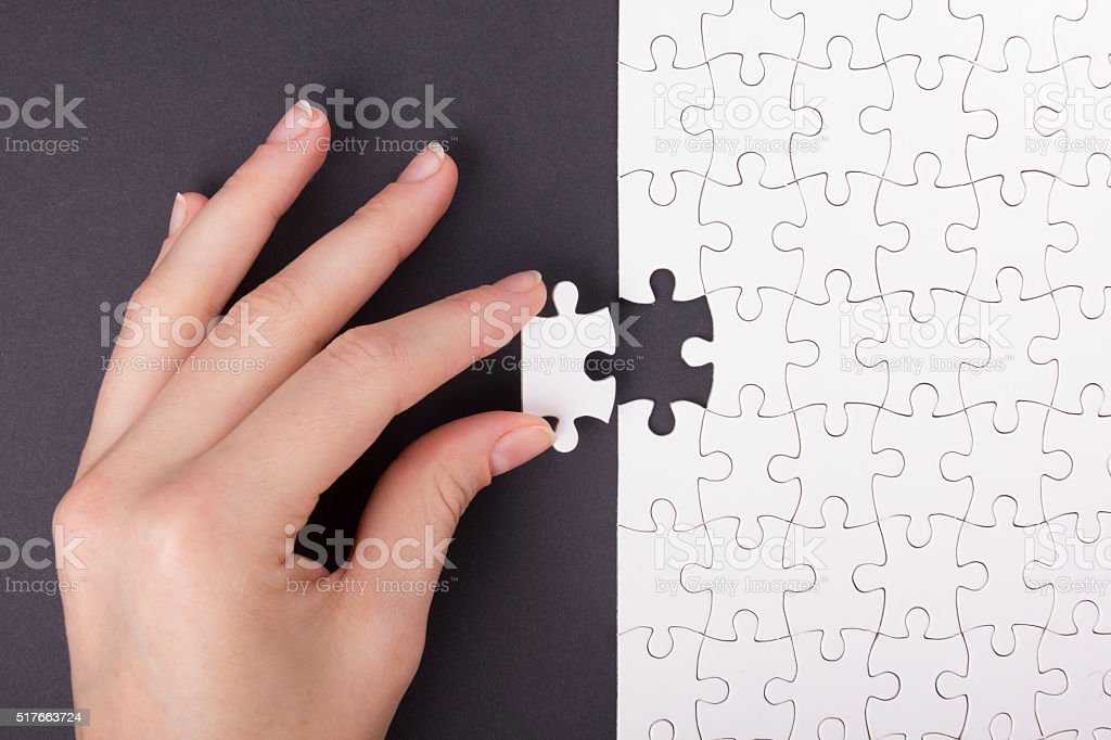 Missing jigsaw puzzle pieces. Business concept. Compliting final task stock photo