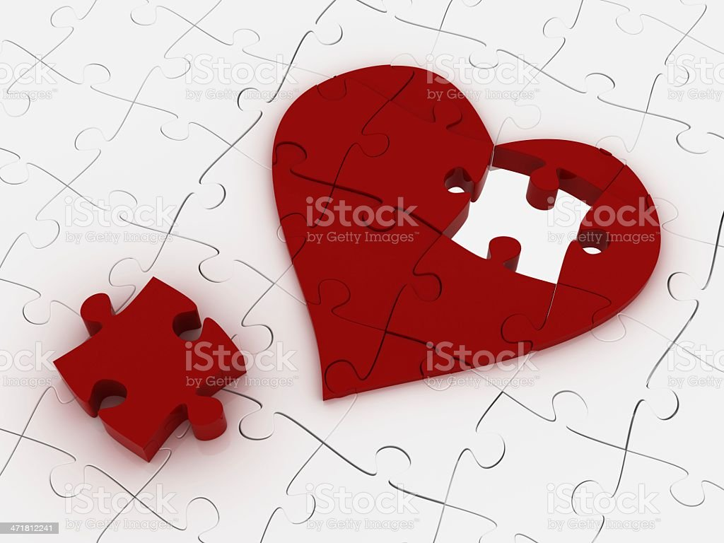 Heart shaped puzzles, one missing part, white puzzles in back.