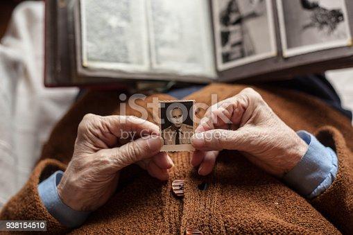 Senior woman with dear photographs .