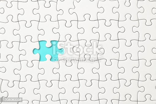 istock Missing piece of a blank jigsaw puzzle 1208080038
