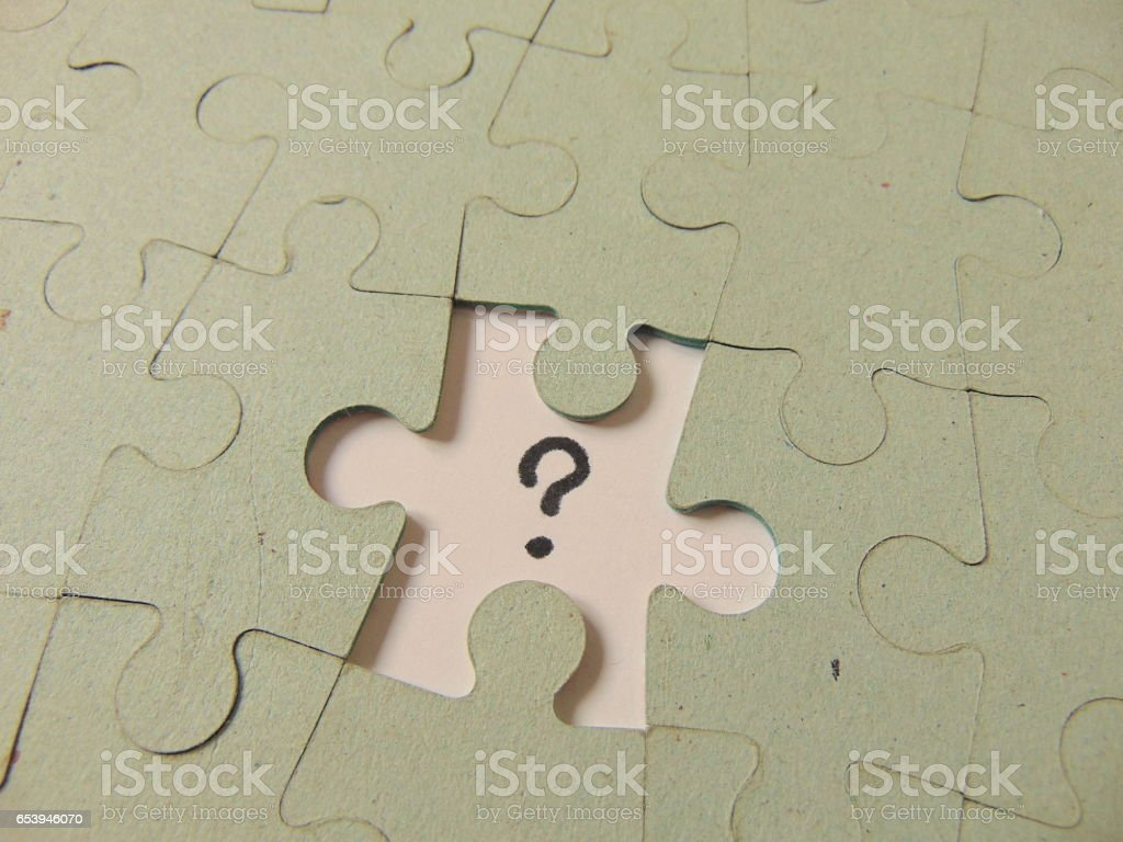 piece of a puzzle missing with a question mark instead