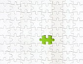 istock Missing piece of puzzle with a green color as background 1263890505