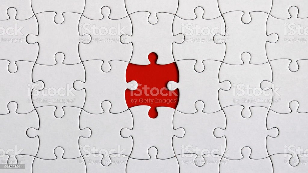 A missing piece of the puzzle. stock photo