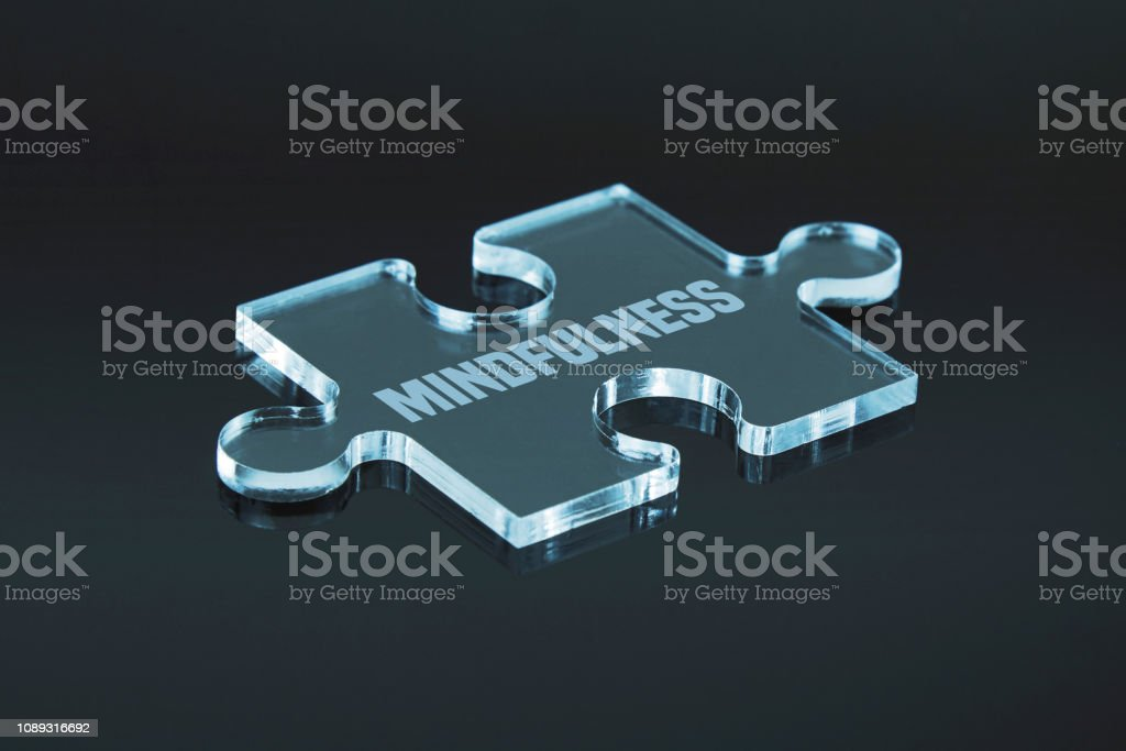 Missing puzzle pieces \'Mindfulness\' concept. Black background with...