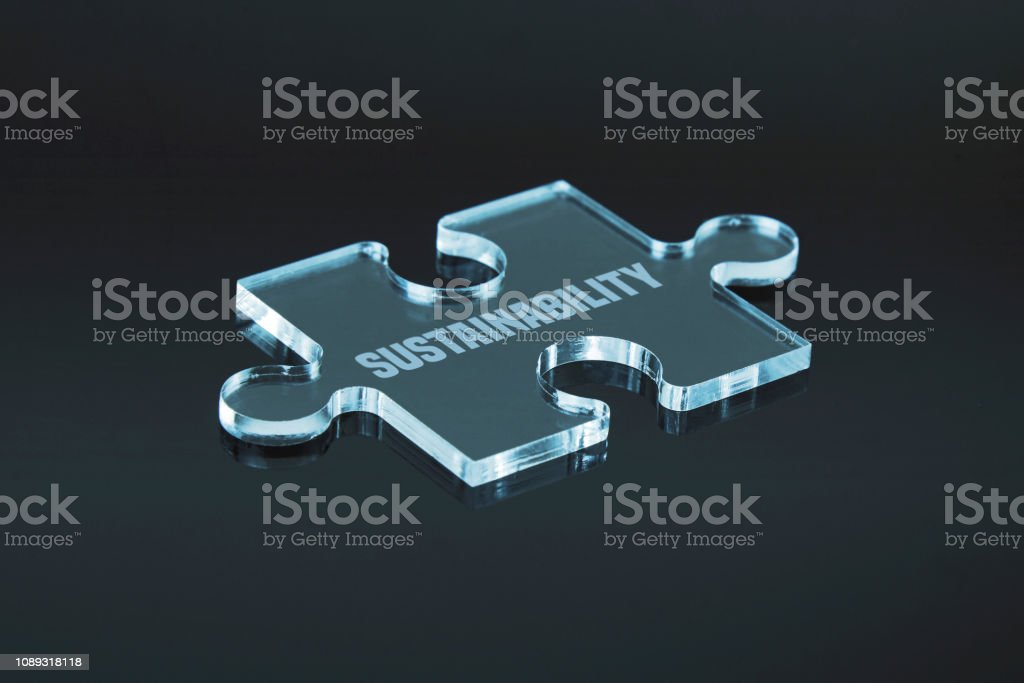 """Missing puzzle pieces """"Sustainability"""" concept. Black background with..."""