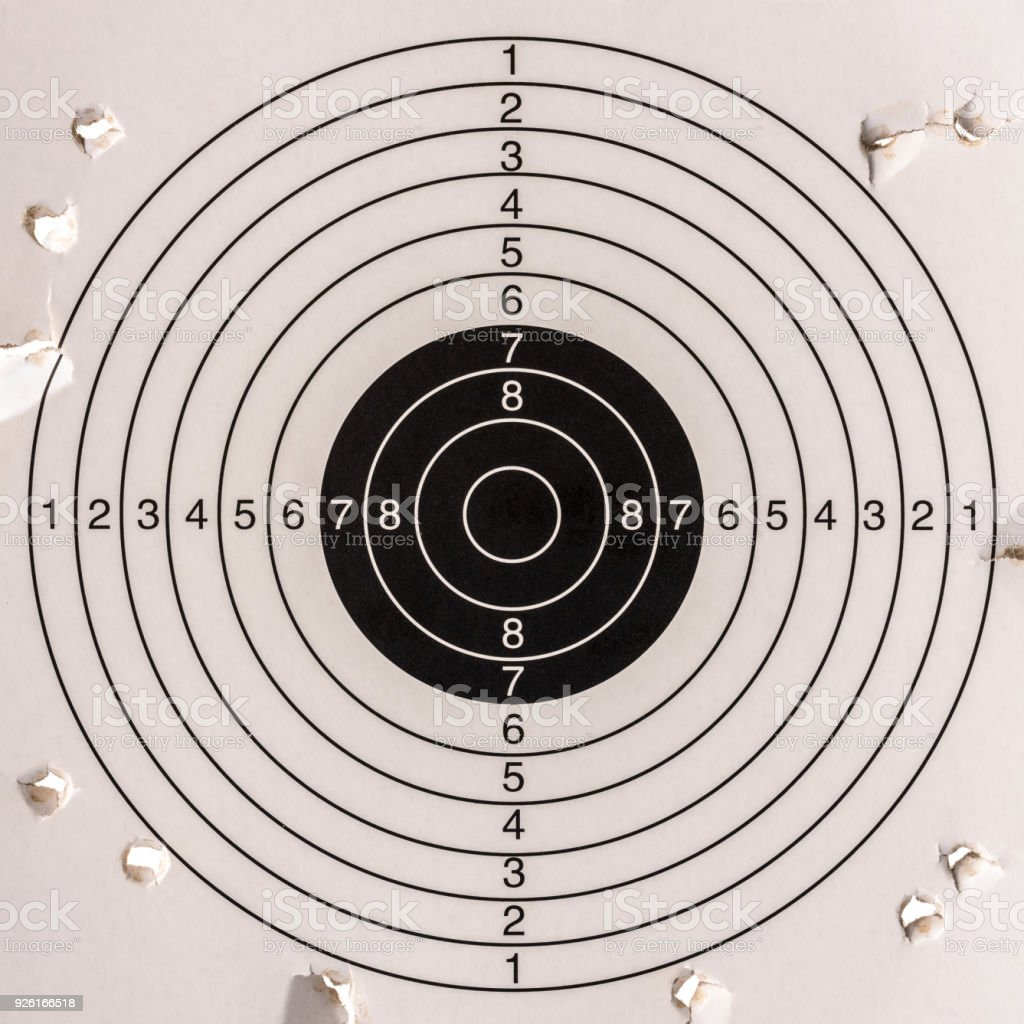 Missing the target, a paper gun target with a very low score. stock photo
