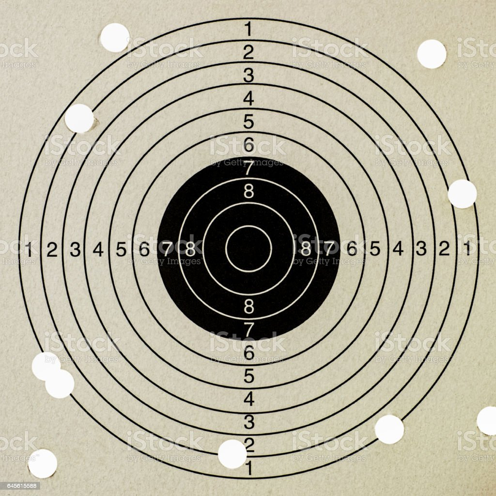 Missing the target, a paper gun target with ten shots and a very low score. stock photo