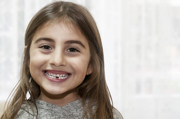 missing tooth - arabic girl stock photos and pictures