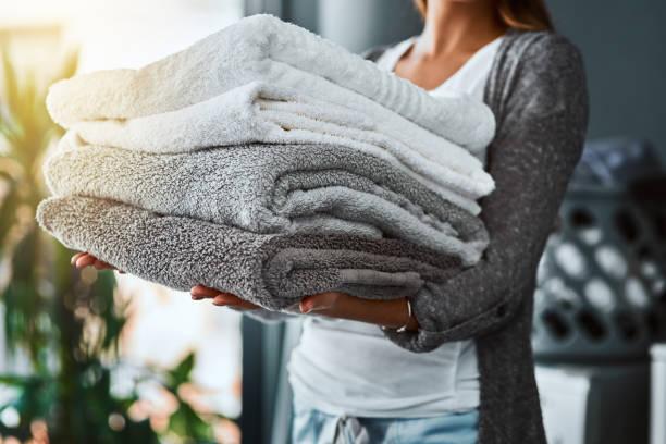 mission accomplished, fresh and clean towels - стирка стоковые фото и изображения