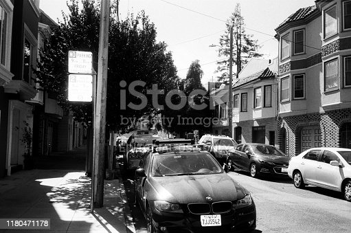 San Francisco, California, United States - October 06, 2019:  Black and white photo on true analog film of street scene in the Mission District neighborhood of San Francisco, California, October 6, 2019