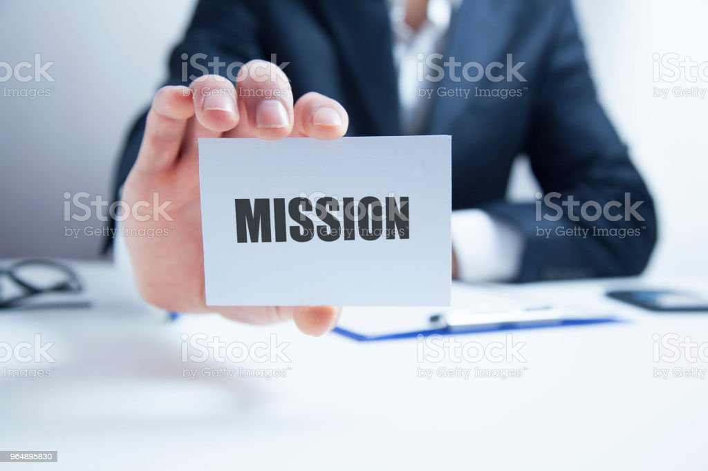 mission message on the card shown by a man royalty-free stock photo