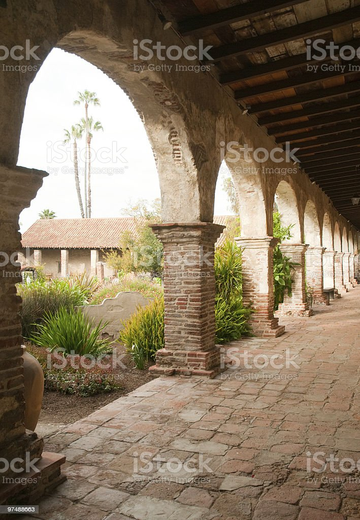 Mission San Juan Capistrano stone arches and gardens royalty-free stock photo