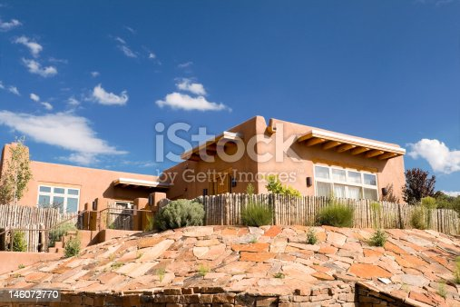 Mission style single family house made of adobe.  Outside Santa Fe, New Mexico, United States.  - See lightbox for more