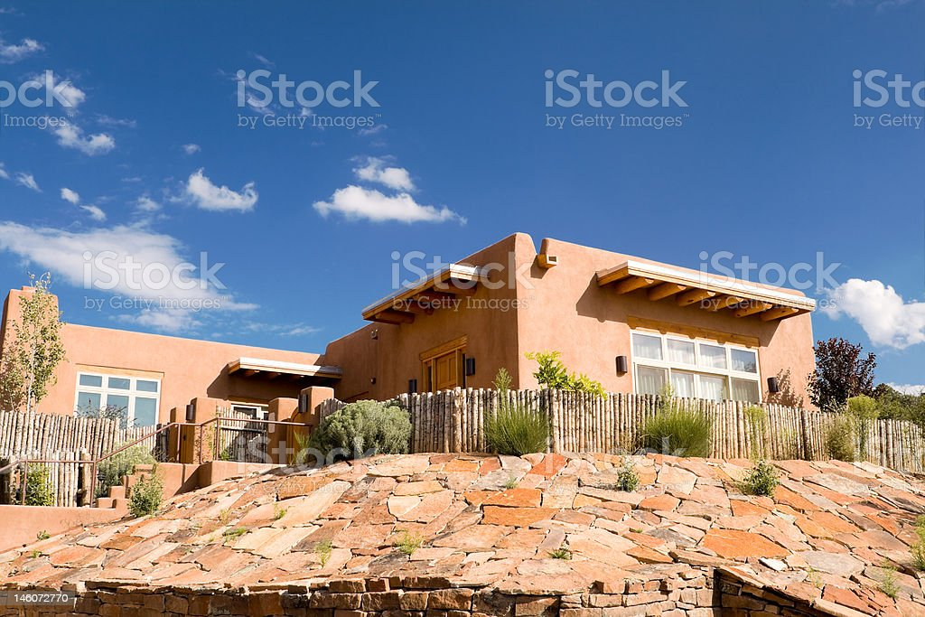 Mission Style Adobe Home, Suburban Santa Fe, NM, Palisade Fence stock photo