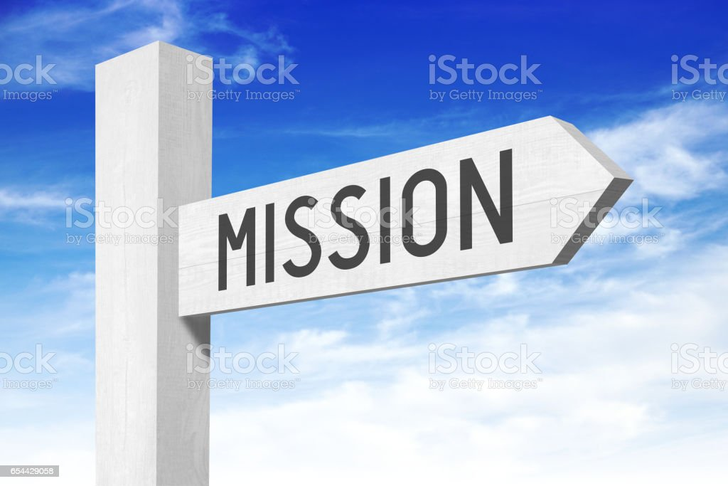Mission - white wooden signpost with one arrow stock photo