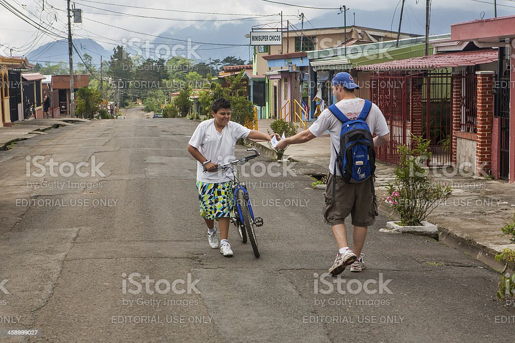 Missionary handing out literature in Costa Rica stock photo