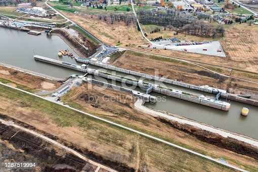A lock on a canal diverting water from the natural flow of the Mississippi River to the east  to overcome the annual variances in water depth on the river in order to maintain the shipping trade in the central United States.  This aerial view is just outside of St. Louis, Missouri on the Illinois side of the river.