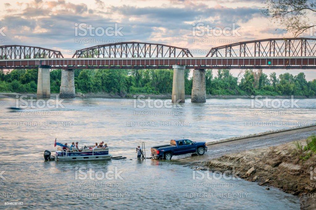 Missouri River and motor boat at a ramp stock photo