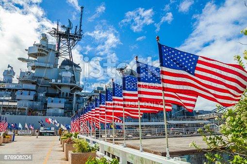 HONOLULU, OAHU, HAWAII, USA - AUGUST 21, 2016:American flags in line at Missouri Warship Memorial in Pearl Harbor Honolulu Hawaii, Oahu island of United States. National historic patriotic landmark.