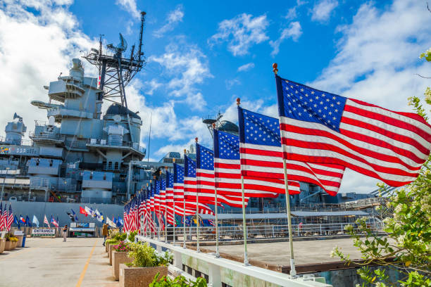 Missouri Warship memorial flags HONOLULU, OAHU, HAWAII, USA - AUGUST 21, 2016:American flags in line at Missouri Warship Memorial in Pearl Harbor Honolulu Hawaii, Oahu island of United States. National historic patriotic landmark. military attack stock pictures, royalty-free photos & images