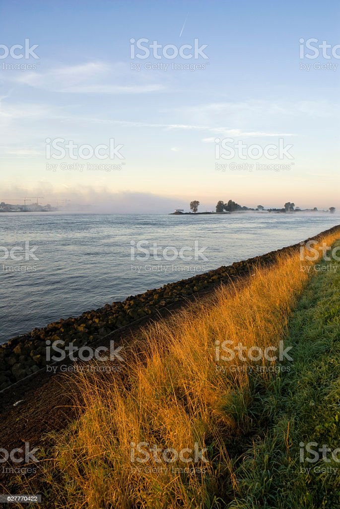 Mist above the river Merwede stock photo