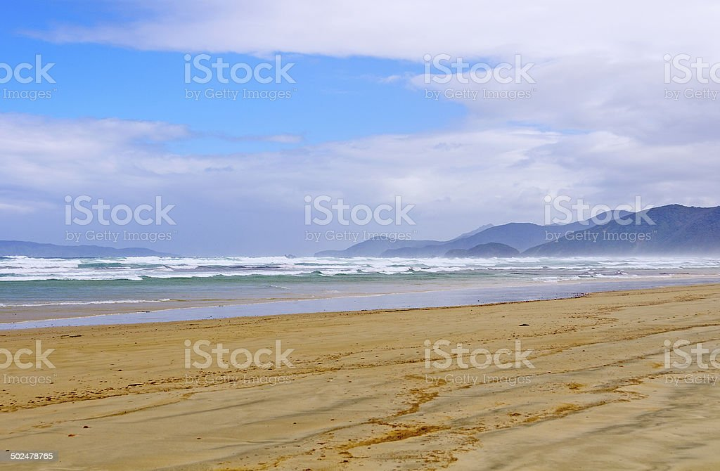 Mist and Waves on a Remote Beach stock photo