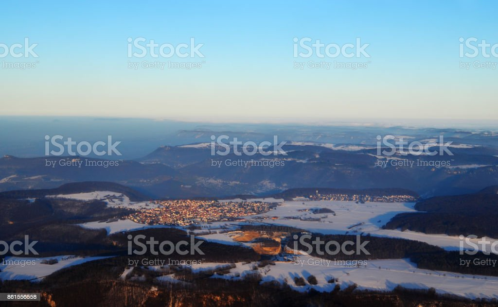 Mist crawling up the Schwäbische Alb in South of Germany stock photo