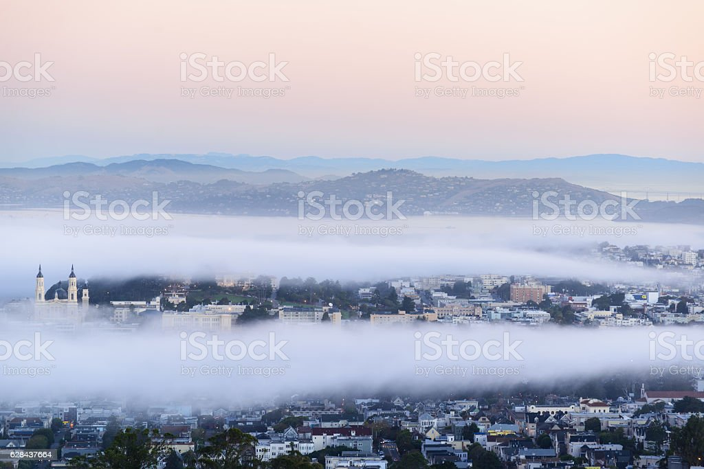 Mist in San francisco when sunrise going stock photo