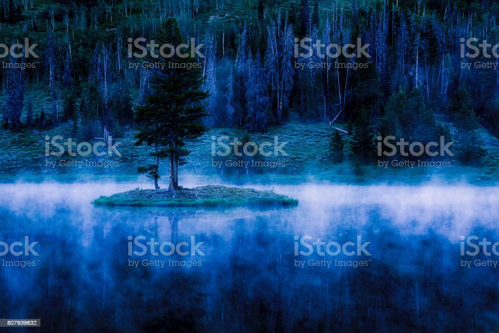 Mist on Hahns Peak Lake at Dawn stock photo