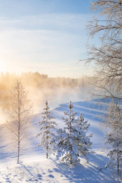 Mist over freezing river on a sunny cold winter day stock photo