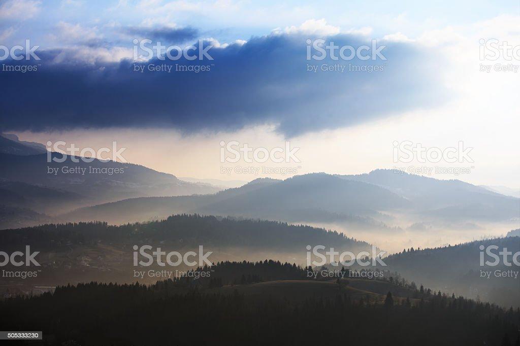 Mist over mountain range stock photo