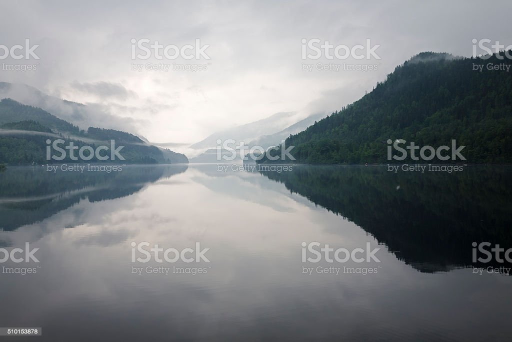 Mist over the water and mountains stock photo