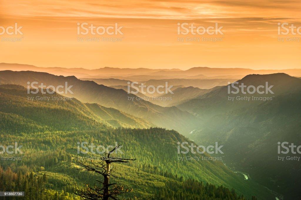 Mist rises on the Sierra Nevada Mountains California USA stock photo