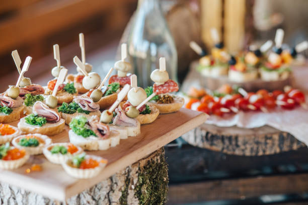 Misted decanter of vodka and traditional Ukrainian snack Beautifully decorated catering banquet table with different food snacks and appetizers on corporate christmas birthday party event or wedding celebration buffet stock pictures, royalty-free photos & images