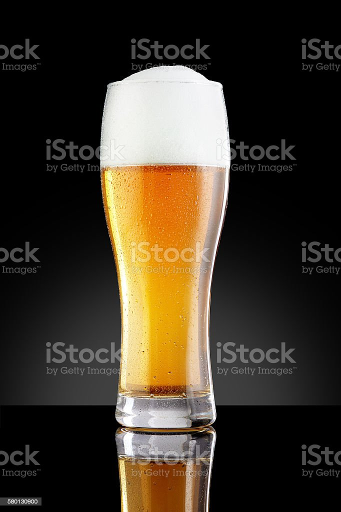 Misted glass of beer stock photo