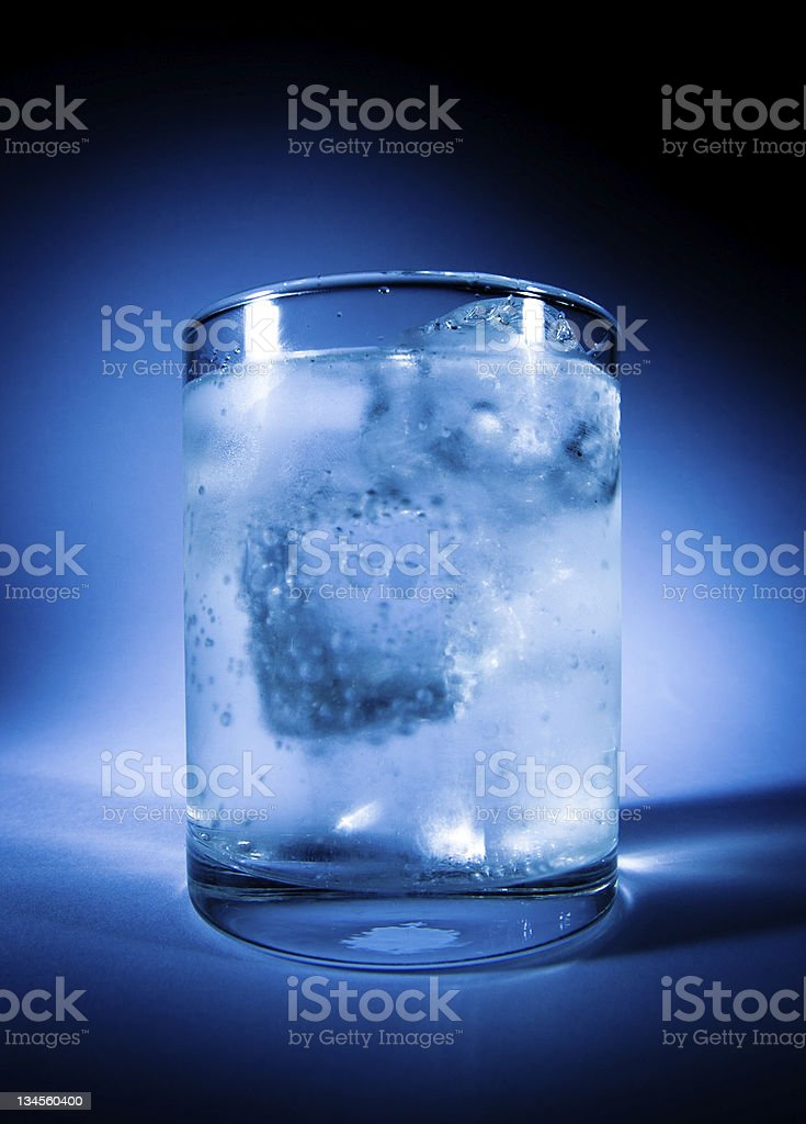 misted over glass of water with ice stock photo