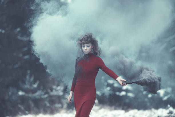 misterious witch with flaming torch - gothic fashion stock photos and pictures