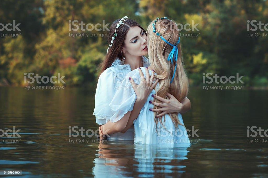 Mistresses women embracing. stock photo