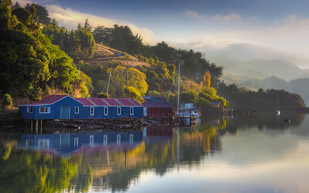 Misty And Calm Morning At Port Chalmers, Dunedin stock photo