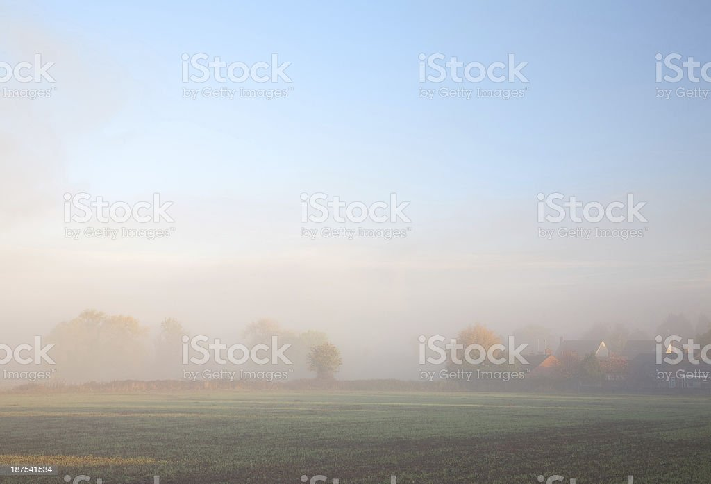 Misty background with houses royalty-free stock photo